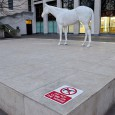 """Do not climb on the horse"" says the warning sign by the eminently climbable and hugely inviting White Horse sculpture on The Mall, in central London."