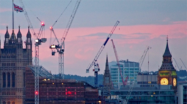 London at dusk: cranes, flags and the Telecom Tower