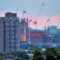 London at dusk: cranes, flags and the Telectom Tower