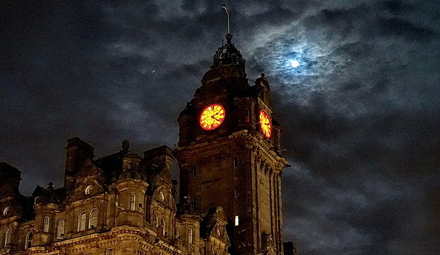 Wet streets, a big Moon and an illuminated station roof: Edinburgh night photos