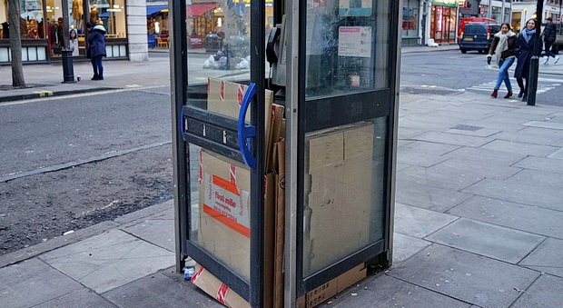 The mystery of the London phonebox that's full of cardboard - in photos