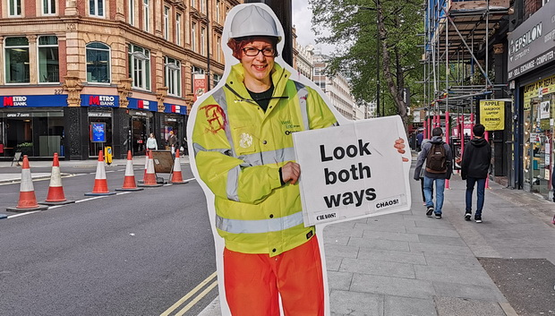 Swing Both Ways - subverted street sign on Tottenham Court Road, London