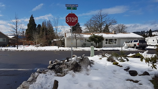 On tour in America: signs, street lights, snow, wires and stop signs