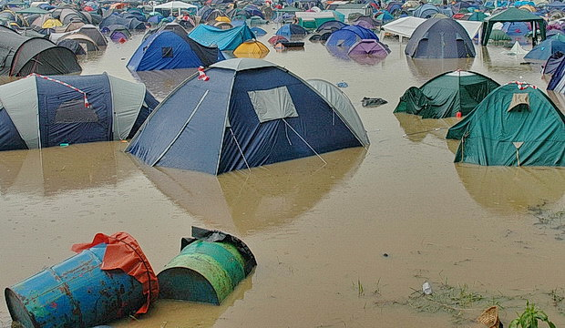 Mud, mud, glorious mud! The swampy boglands of Glastonbury Festival in photos, June 2005