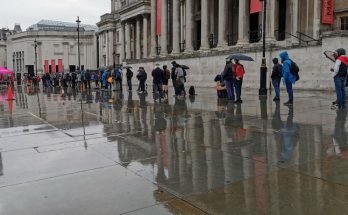 London's shame: long line of hungry homeless people queuing in the rain at Trafalgar Square