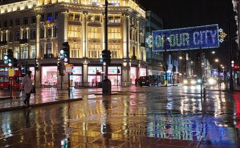 Tinseltown in the rain: Oxford Street Christmas lights in a late night downpour, Dec 2020
