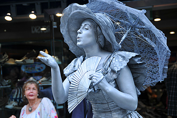 Photos of Covent Garden market and street performers and buskers, Covent Garden, London WC2, London