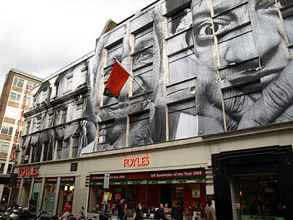Artwork papered onto Foyles and surrounding buildings, Manette Street, central London
