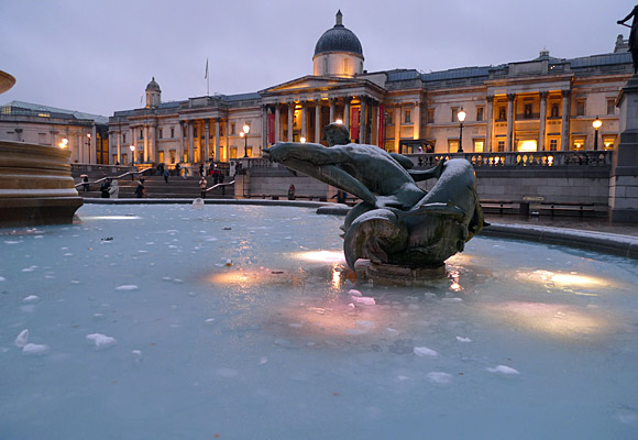 London snow scenes - frozen fountains in Trafalgar Square and snow on