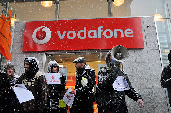 Brixton protest against tax dodgers Vodafone and Topshop, Brixton Road, London 11am, 18th December 2010