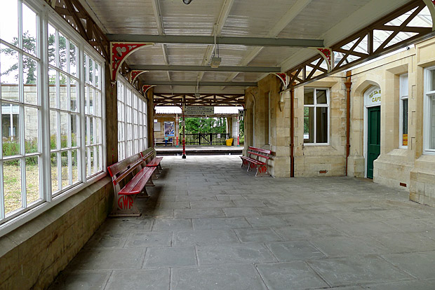 Kemble railway station, Gloucestershire, with photos of station platforms, buildings, canopy and footbridge and Cirencester branch platform